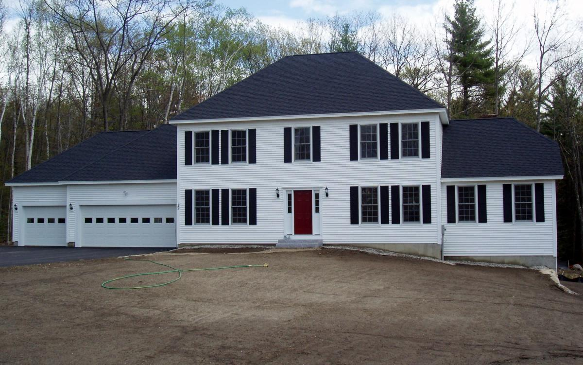 Four Bedroom Hip Roof Colonial with three Car Garage