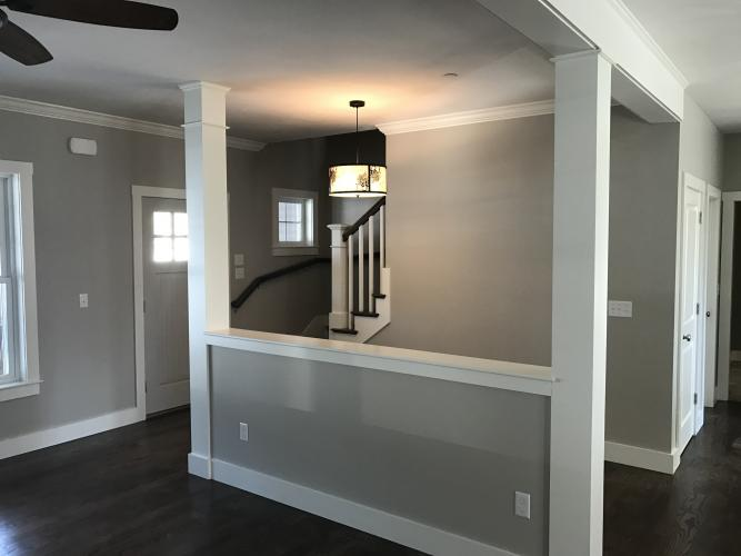 Open concept with first floor master suite, in-aw suite and 3 car garage